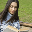 Stock Photo: Young womin park reading
