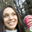 Foto Stock: Beautiful girl in park drinking coffee