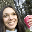 Beautiful girl in park drinking coffee — стоковое фото #2925978