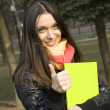 Foto Stock: Female in park with folder