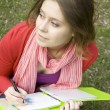 Female in the park draws - Stock Photo