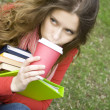Lunch is a student in the park - Stock Photo