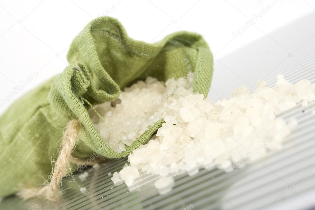 Bath salts are poured out from the green bag  Stock Photo #3070145