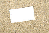 Businesscard on sand — Stock Photo