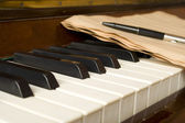 Piano with notes — Stock Photo