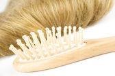 Hair and a wooden comb — Stock Photo