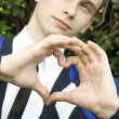 Teen boy making heart shape with hands — Stock Photo
