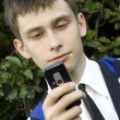 Young man looking at mobile phone — Stock Photo