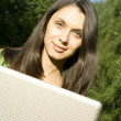 Foto Stock: Womwith Laptop