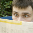 Young man Reading Newspaper — Stock Photo