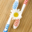 Two toothbrushes and chamomile - Stock Photo