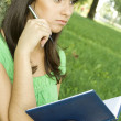 Female in a park with a notebook — Stock Photo #3552492