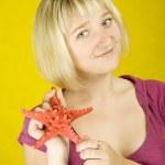 Woman holding starfish — Stock Photo #3552670