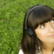 Young woman listening to music — ストック写真