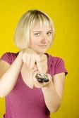 Woman & remote control — Stock Photo