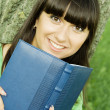 Female in a park with a notebook — Stock Photo #3607466