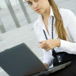 Business woman with laptop - Stock Photo