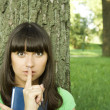 Stockfoto: Female in a park with a notebook