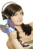 Woman listening to music and singing — Stock Photo