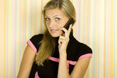 Young woman on phone — Stock Photo