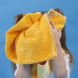 Small girl is wiping its face by towel isolated — Stock Photo