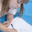Small cute girl is sketching — Stock Photo