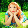 A redhead laying in a meadow — Stockfoto