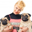 Royalty-Free Stock Photo: Cute blonde holding two pugs