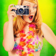 Pinup girl in a bikini holding a vintage camera — Stock Photo #3521401