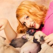 A redhead playing with puppies — Stock Photo #3521688