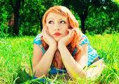 A redhead laying in a meadow — Stock Photo