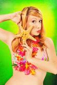 Pinup girl wearing lei — Stock Photo