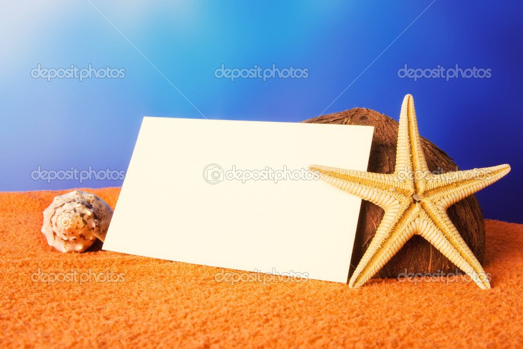 Holiday beach concept with shells, sea star and a blank postcard on a beach towel  — Stock Photo #3521289
