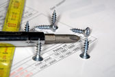 Screwdriver and screws — Stock Photo