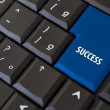 Black keyboard with a key to success — Stock Photo