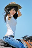 Girl with pistol portrait — Stock Photo