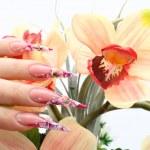 Manicured acrylic nails — Stock Photo