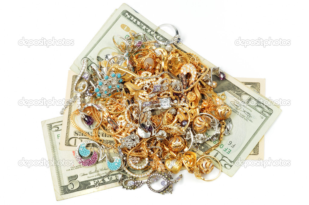 Dollars and gold jewerly on white background  Stock Photo #3686078