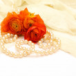 Flowers and pearls — Stock Photo