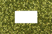 Background of dried green peas with white place — Stock Photo