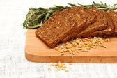 Bread, rosemary and wheat germ — Stock Photo