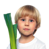 Happy child with green vegetable — Stock Photo
