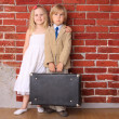 Little boy in a suit and a beautiful girl in a white dress — Stock Photo