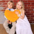 Royalty-Free Stock Photo: Little boy and beautiful girl with heart