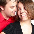 Stock Photo: Closeup portrait of a happy young couple looking at each other