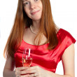Young woman holding glass of champagne — Stock Photo