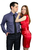 Man looks at a woman. beautiful couple isolated on white — Stock Photo