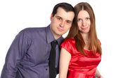 Handsome couple. Man embraces woman in red dress. — Stock Photo
