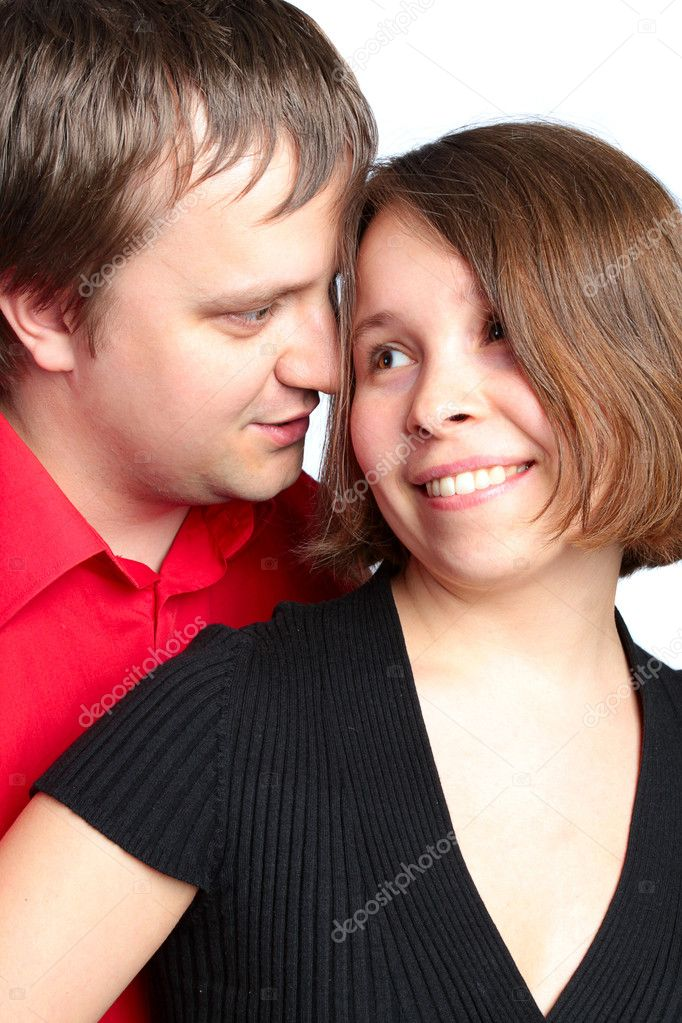 Closeup portrait of a happy young couple looking at each other  Stock Photo #3342728