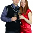 Royalty-Free Stock Photo: Happy couple. Laughing woman and man with a glass of champagne.